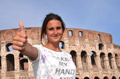 Beautiful attractive brunette tourist girl close to majestic Colosseum in Rome, Italy Stock Photography
