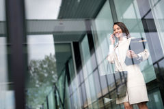 Beautiful and attractive businesswoman talking on cellphone Stock Image