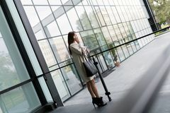 Beautiful and attractive businesswoman talking on cellphone Stock Photography