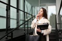 Beautiful and attractive businesswoman texting on cellphone Royalty Free Stock Photos