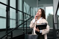 Beautiful and attractive businesswoman texting on cellphone Stock Image