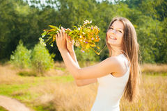 Beautiful attractive carefree brunette girl in field Stock Images