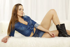Beautiful and attractive female woman posing in blue jeans dress Stock Photos