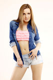 Beautiful and attractive female woman posing in blue jeans dress Royalty Free Stock Image
