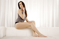Beautiful and attractive female woman posing in grey shirt on th Royalty Free Stock Images