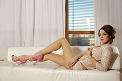 Beautiful and attractive female woman posing in pink lingerie on Royalty Free Stock Photos
