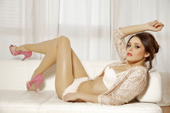 Beautiful and attractive female woman posing in pink lingerie on Stock Photography