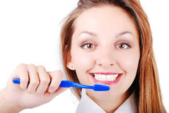 Beautiful attractive girl brushing her very  brigh Royalty Free Stock Image