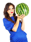 Beautiful attractive girl holding heavy watermelon. Royalty Free Stock Images