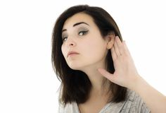 Beautiful and attractive girl listening gesture over a white bac Royalty Free Stock Image