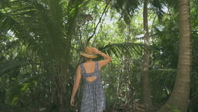 Beautiful attractive girl walking on a tropical island. During the day stock footage