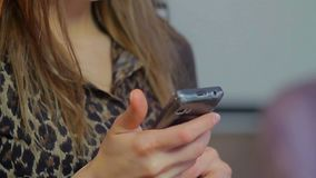 Beautiful attractive lady typing message close-up flirting phone. Stock footage stock video
