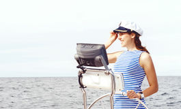 Beautiful, attractive sailor girl driving a boat. Sea, navigatio Stock Photo