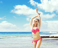 Beautiful, attractive and girl in pink swimsuit posing on a Stock Photography