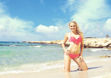 Beautiful, attractive and girl in pink swimsuit posing on a Stock Photos