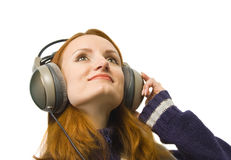 Beautiful attractive smiling woman with headphones Royalty Free Stock Photos