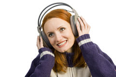 Beautiful attractive smiling woman with headphones Stock Photography