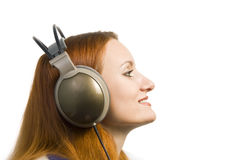 Beautiful attractive smiling woman with headphones Royalty Free Stock Images