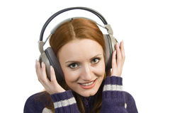 Beautiful attractive smiling woman with headphones Stock Photos