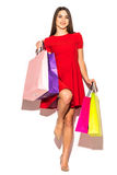 Beautiful attractive woman with color shoping bags in hands on white background. Summer. Stock Photo