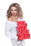 Beautiful attractive woman holding red gift box isolated on whit Royalty Free Stock Photos