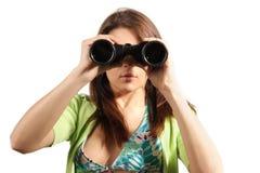 Beautiful, attractive woman looking through binocu stock images