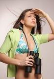Beautiful, attractive woman looking through binocu stock photos