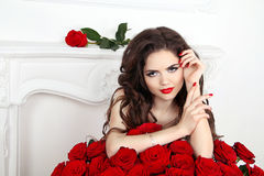 Beautiful attractive woman with makeup, red roses bouquet of flo royalty free stock images