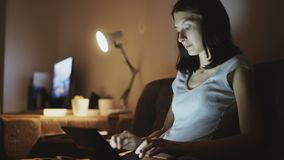 Young attractive woman sharing social media using on laptop computer at home in night time. Beautiful attractive woman sharing social media using on laptop stock footage