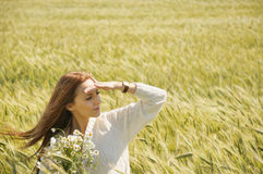 Beautiful attractive woman in sunny autumn field with bunch of c Royalty Free Stock Photography