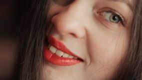 Beautiful attractive young girl. A joyful look. Sensual lips. Face close-up. stock video footage