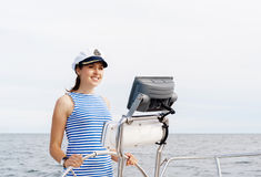 Beautiful, attractive young girl pilots a boat Mediterranean Sea Royalty Free Stock Photo