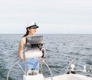 Beautiful, attractive young girl pilots a boat Mediterranean Sea Stock Photos