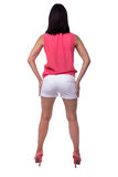 Beautiful, attractive young woman in blouse and short shorts with an elegant figure, buttocks, ass, standing backwards Royalty Free Stock Photos