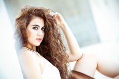 Beautiful and attractive young woman, long curly hair royalty free stock images