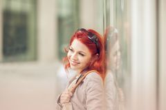Beautiful, attractive young woman with red hair relaxing in town, shopping. Walking, summerly urban mood Stock Photo
