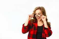 Beautiful attractive woman in round glasses over white backgroun Stock Photos