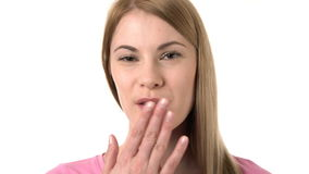 Beautiful attractive young woman smiling into camera. Isolated white background. Sending kiss. stock video footage