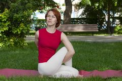 Beautiful attractive young woman stretching exercising in the park royalty free stock photos