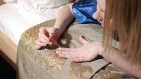 Beautiful attractive young women in bedroom paints nails.  stock video footage