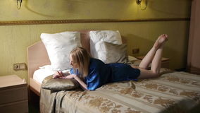 Beautiful attractive young women in bedroom paints nails.  stock video