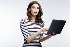 Beautiful auburn-haired woman working on laptop Stock Photography