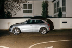 Beautiful AUDI SUV car parked in night city Stock Photography