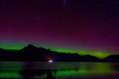 Beautiful Aurora Australis and milky way over Lake Wakatipu, Kinloch, New Zealand South Island Stock Photos