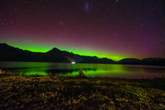 Beautiful Aurora Australis and milky way over Lake Wakatipu, Kinloch, New Zealand South Island Royalty Free Stock Photo
