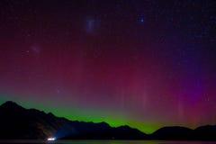 Beautiful Aurora Australis and milky way over Lake Wakatipu, Kinloch, New Zealand South Island Stock Photo