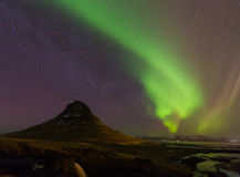 Beautiful aurora dancing with fully of stars on the sky Royalty Free Stock Photo