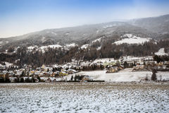 Beautiful Austrian highland town covered with snow Royalty Free Stock Images