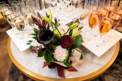 Beautiful authors flowers bouquet and champagne on the table. Luxury event catering stock image