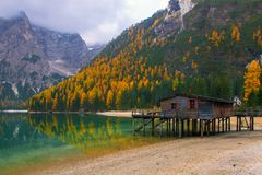 Beautiful autumn alpine landscape, spectacular old wooden dock house with pier on Braies lake, Dolomites, Italy. Beautiful autumn alpine landscape, spectacular royalty free stock photos